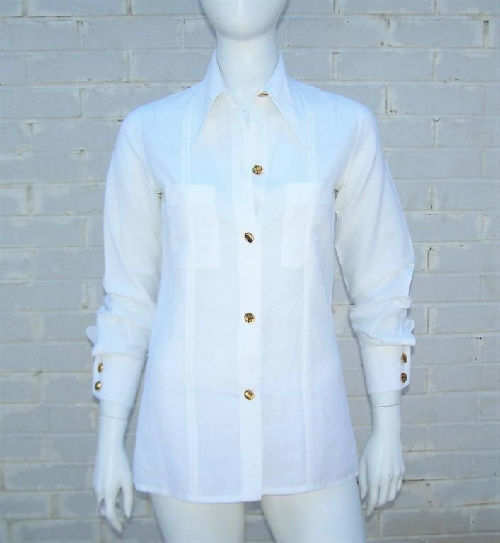 Every summer wardrobe needs a crisp white shirt.  Gucci designed just the thing in a linen cotton blend with 1970's details and nautically inspired buttons.  The menswear style shirt buttons at the front with an exaggerated pointy collar, inverted