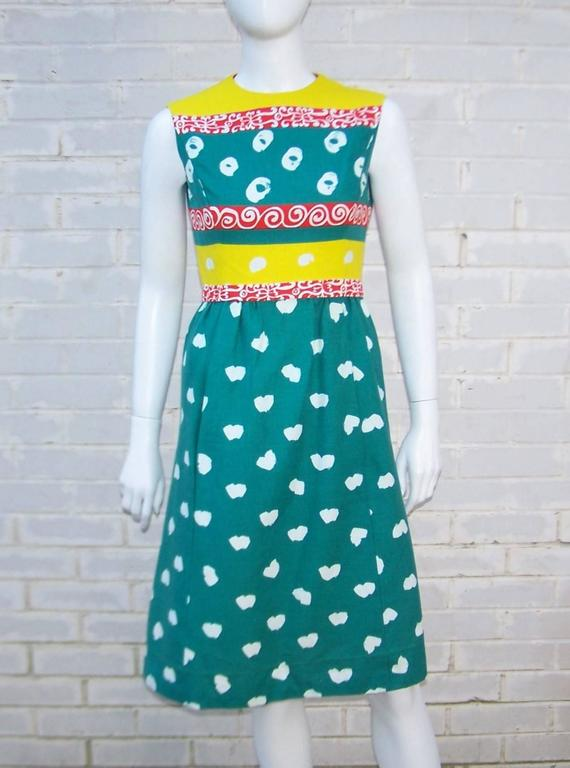 Get ready for a color punch with this C.1970 Elinor Simmons design for Malcolm Starr.  The two piece dress set combines teal green, bright yellow, tomato red  and white colors in a heavy linen fabric.  The abstract pop art patterns are akin to a