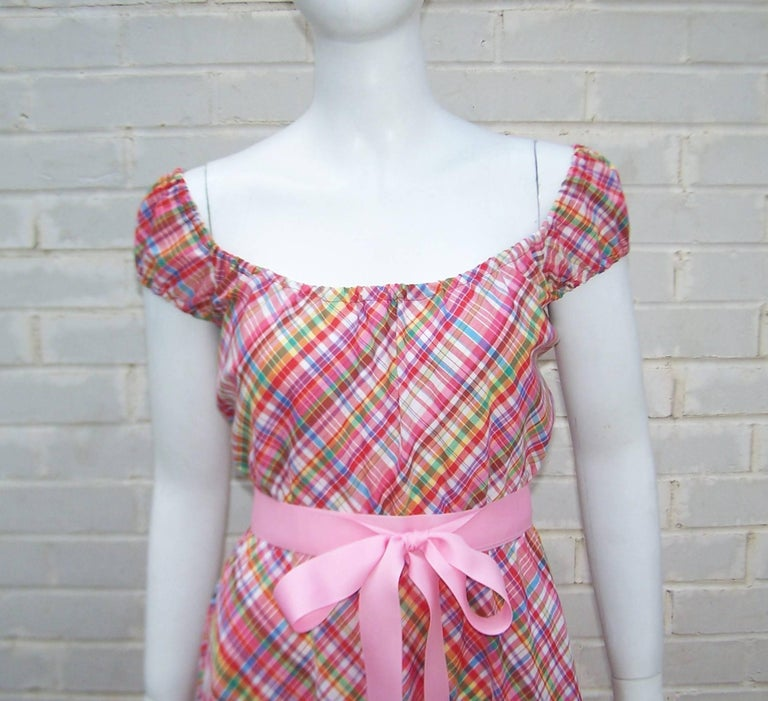 This cute 1970's Clovis Ruffin dress is light and summery with a youthful silhouette.  The dress is constructed with an easy pull on style typical of Mr. Ruffin's designs and has elasticized neckline, sleeves and waist to keep everything in place.