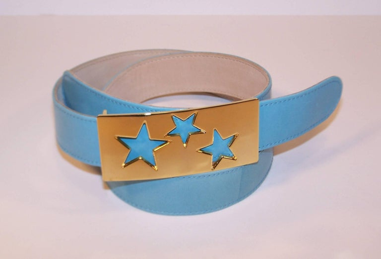 Stars are on display with this whimsical belt from Escada.  The rectangular gold tone metal buckle features star cut-outs which reveal the sky blue leather belt below.  It can easily adjust for three sizes.  Even though Escada is based in Germany,
