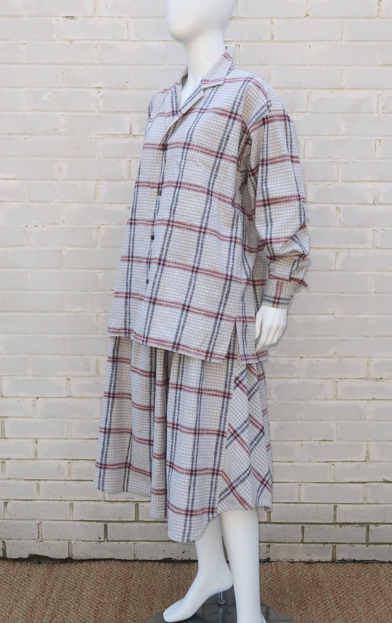 This nubby cotton windowpane plaid 2-piece ensemble by Issey Miyake for his Plantation line is reminiscent of vintage Japanese farmer's clothing.  The menswear style shirt top buttons up the front and cuffs with side vents and breast pocket.  The