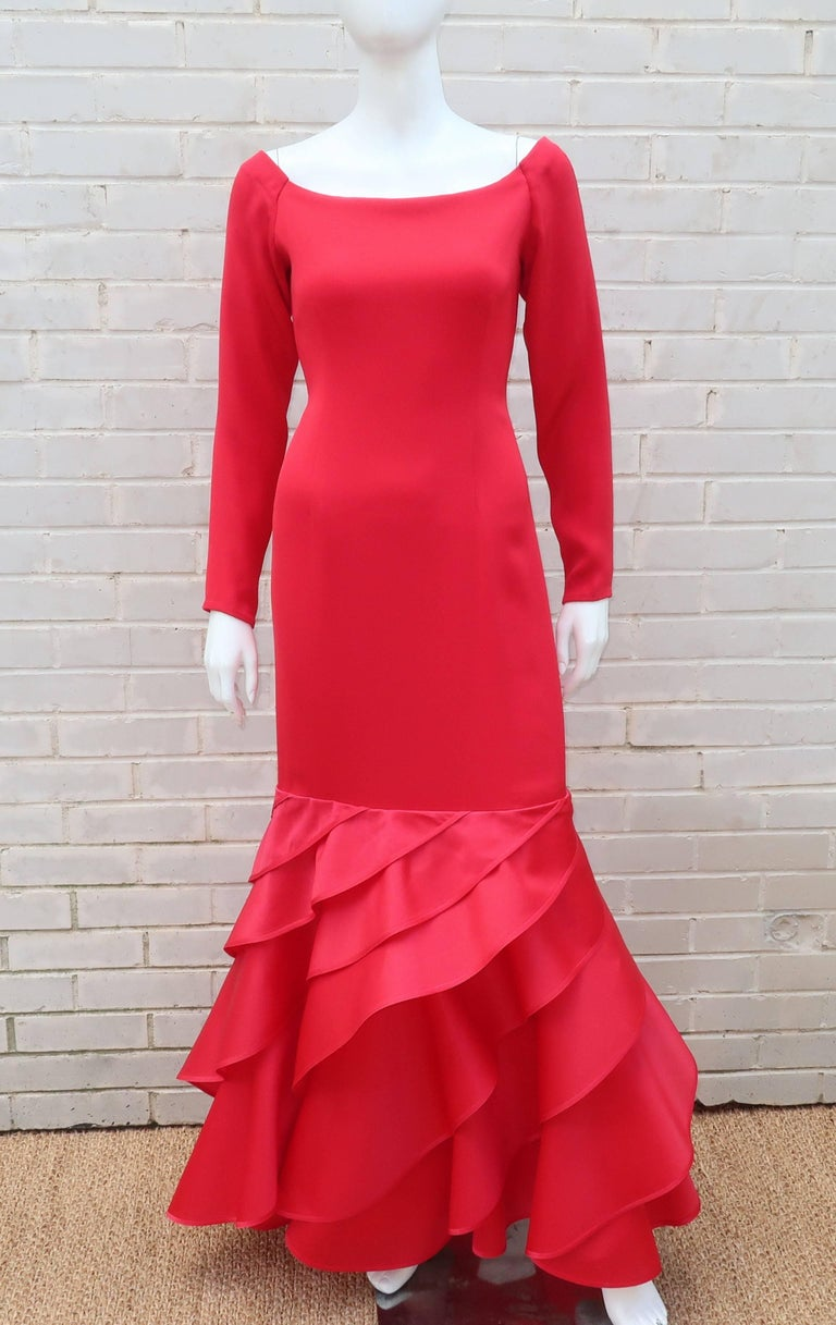 This lipstick red silk evening dress epitomizes the drama of 1980's fashion and Bill Blass' talent for creating luxurious designs.  The dress is seamlessly constructed in two parts ... the heavy lined silk upper body zips and hooks at the back with