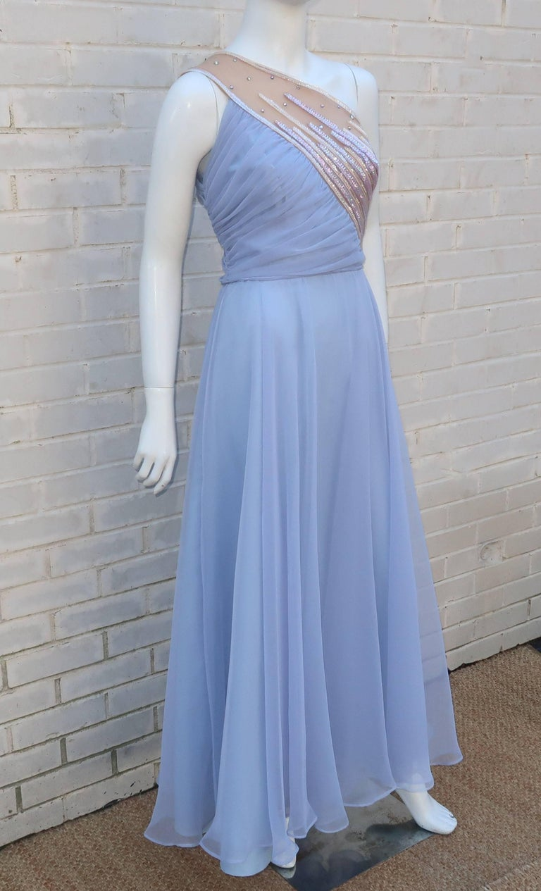 This Al Diamond design inspired by his glamorous wife and label namesake, Lilli Diamond, is a whole lot of glamour in a chiffon package.  The one-shouldered silhouette zips and hooks at the side with an emphasized waist and full skirt.  The chiffon