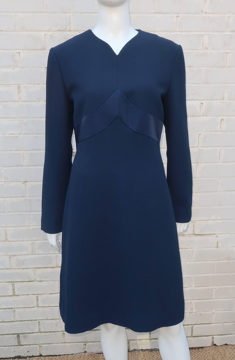This elegant dress from Carolina Herrera Studio features a simple design with subtle details providing a versatile look that works well for day or evening wear.  The fabric appears to be a silk blend similar in weight to a crepe and is a dark blue