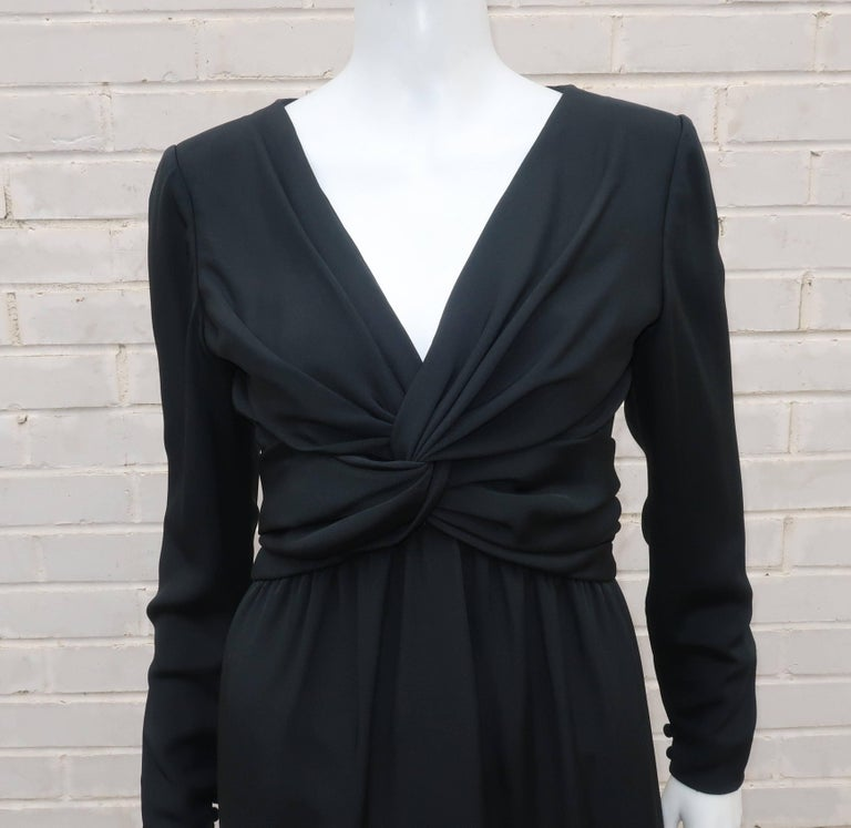 Bill Blass puts a sophisticated twist on the 'little black dress'.  This sleek design is fabricated from a fine silk faille with a ruched detail at the bodice that criss crosses to create a fashionable twisted knot at the bust.  It zips and hooks at