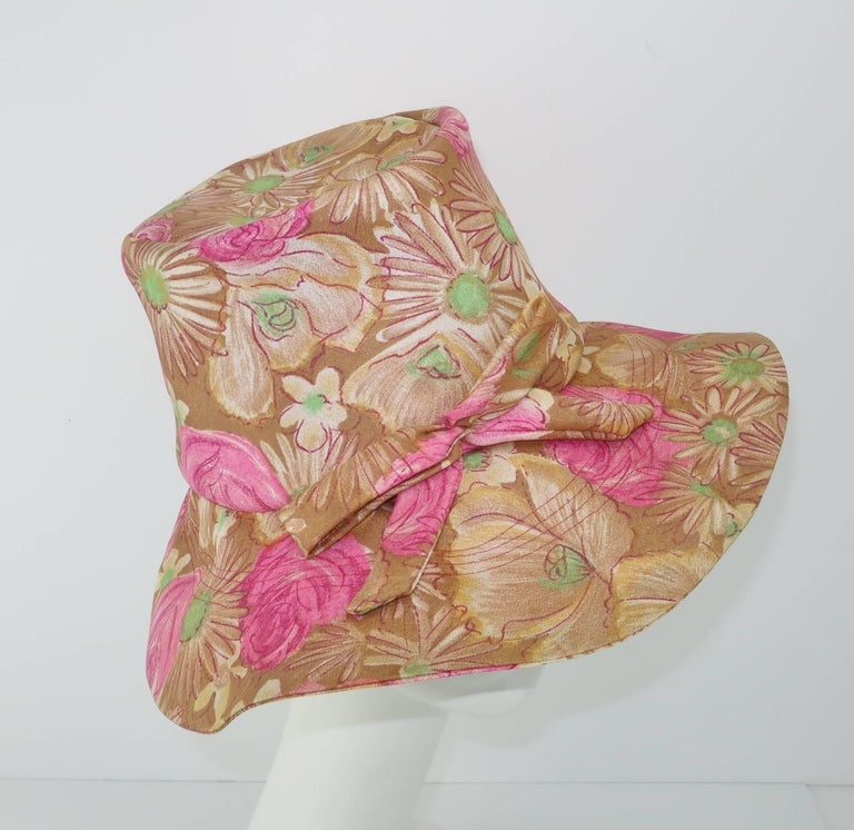 Fun and floppy with a purpose!  This 1960's hat from Claire Ann of Flushing, NY has the hidden secret of structure which gives the floppy design a stylized silhouette reminiscent of fashion shoots from the era picturing models in fields of daisies.