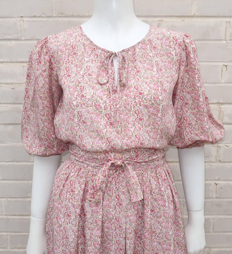 Oscar de La Renta's knack for creating ultra feminine designs with a touch of the romantic is at play in this lovely two piece silk peasant dress ensemble.  The pullover top ties at the neck with 3/4 balloon sleeves that pool at the button cuff and