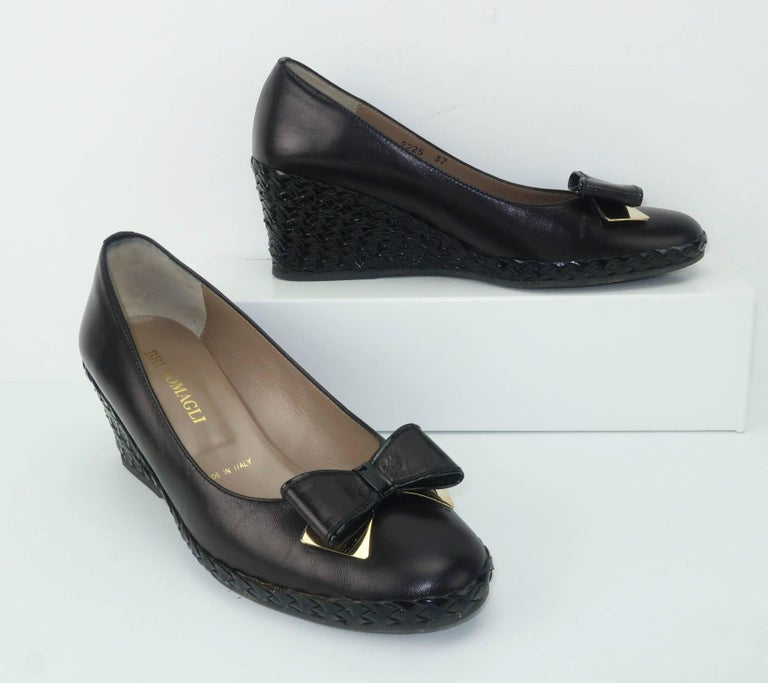 Bruno Magli has been producing quality Italian leather goods since 1936.  These comfortable black leather shoes have an espadrille style patent woven 2.5