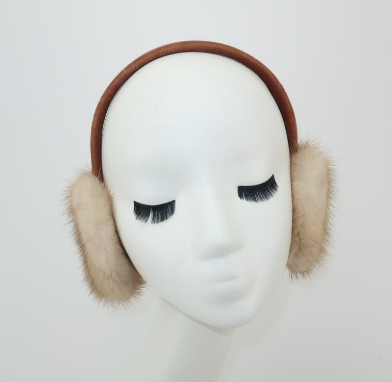 What an adorable way to fend off the winter chill!  These vintage ear muffs are fabricated from blonde mink fur and a light brown velvet covered headband.  Very good condition with light wear to the velvet fabric at the edges of the band as shown in