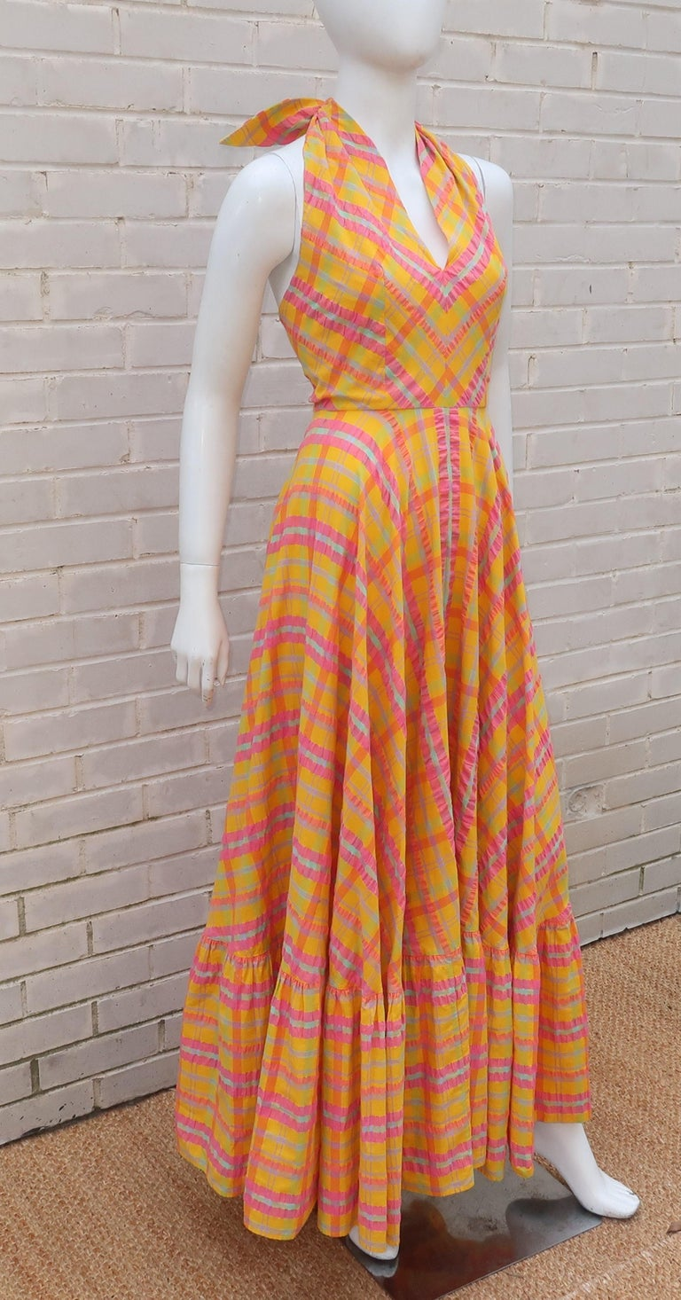 This 1960's Dior Boutique dress for Saks FIfth Avenue is a breath of fresh air in a splash of sunny colors including yellow, orange, pale green, lavender and watermelon pink.  The cotton seersucker plaid fabric is the perfect foil for the peasant