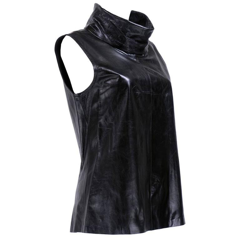 Wonderfully constructed fine leather tunic with roll down funnel neck. Unlined and zips up back.