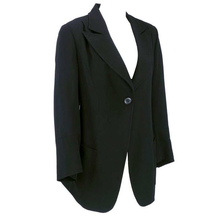 Signature detailed tailoring for Ann Demeulemeester in this circa 1990s black fleece wool relaxed blazer cut jacket. Fully lined , single button closure. Tie back waist for flexible fit.  exaggerated peak collar. Timeless classic. Excellent