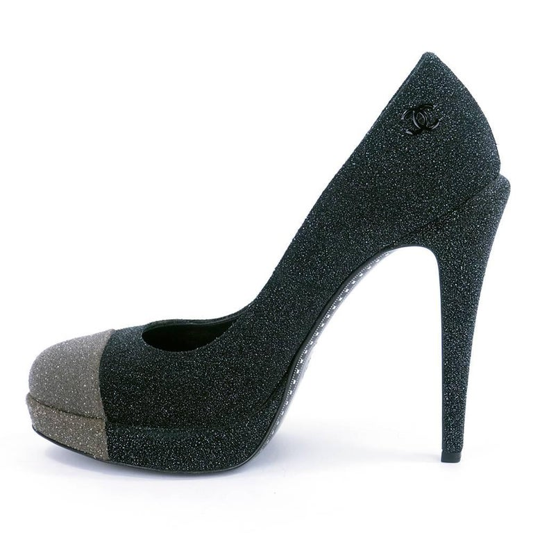 Never worn Chanel platform pumps in black and grey with glitter effect. 5 inch heels with 1/2 platform . Double C logo on heel. Super sexy!