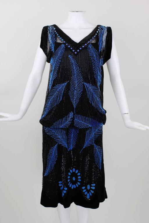 1920s black velvet and blue beaded feather evening dress