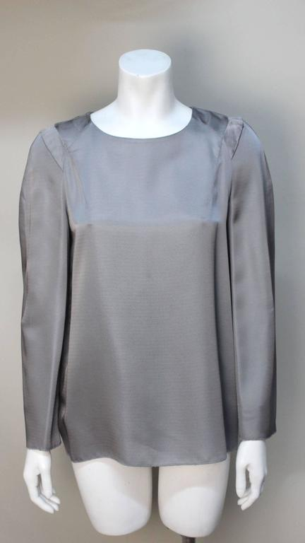 This Marnie top is simple but beautifully designed. The fine silver grey rayon drapes beautifully. The shoulders are defined with extended rounded stitched pleats. The addition of pockets is a nice touch.