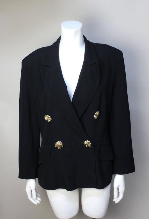 SALE!  Originally  $275 This Moschino jacket has a wonderful lining with the Cheap & Chic logo along with the date of the collection: Spring 1991 Collection No. 6. The fabric is a fine rayon that drapes beautifully on the body. It is double