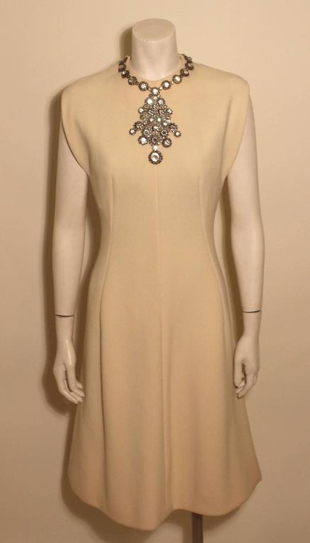 Made of a fine cashmere wool, this Trigere dress is extravagant. It is beautifully executed with a rhinestone necklace attached to the front and neckline of the dress.