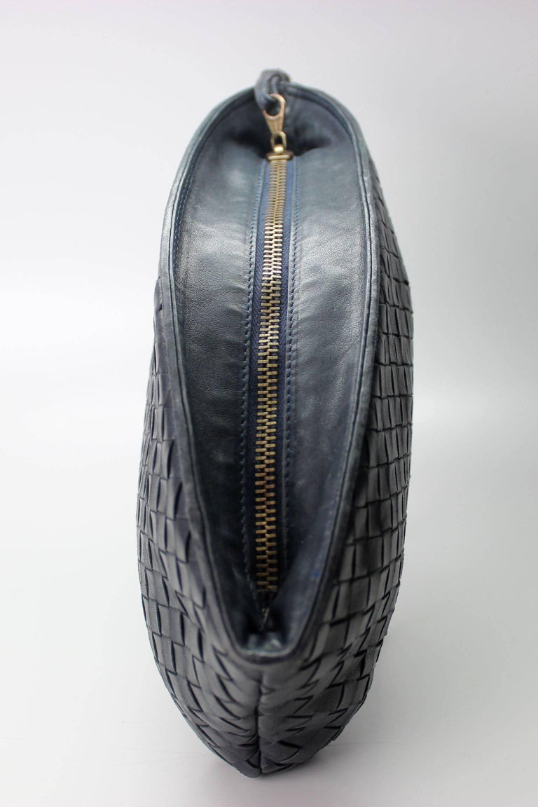 This navy blue Bottega Veneta clutch bag is made of  fine strips of lambskin woven together in the brands iconic intrecciato technique. This timeless, understated style makes it instantly recognizable as a  Bottega Veneta design. Dustbag included.