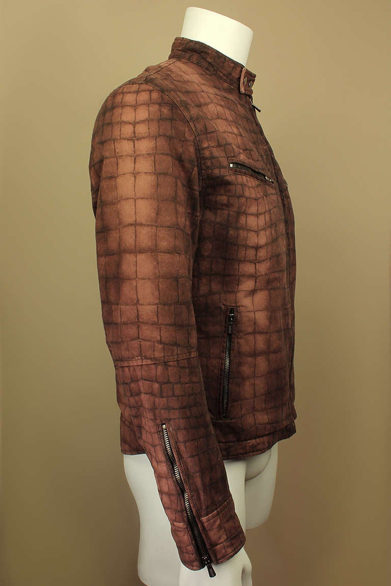 This Moschino jacket is on trend as much now as it was in the 1990s. The rich brown reptile print is very au courant as are the four functional zippered pockets.