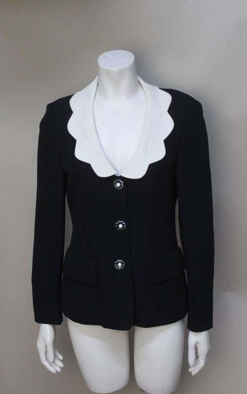 This Moschino Cheap & Chic jacket is pure Moschino in its whimsical details. The fine rayon fabric drapes nicely. It has lots of character with its low scalloped white collar and daisy buttons on the front and cuffs.