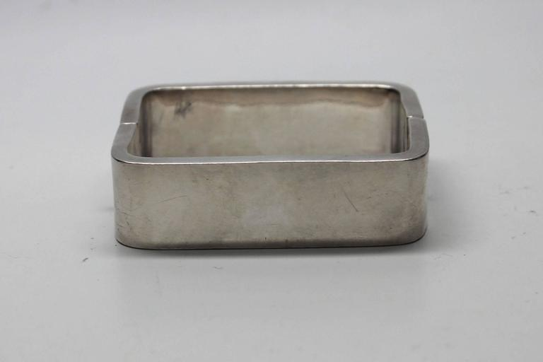 This hinged bracelet is a great statement piece. It has substantial weight and is stamped, Sterling Mexico. The jewelers mark is AAE and it has an early eagle mark. When shut the rectangle shape fits comfortably on the wrist.