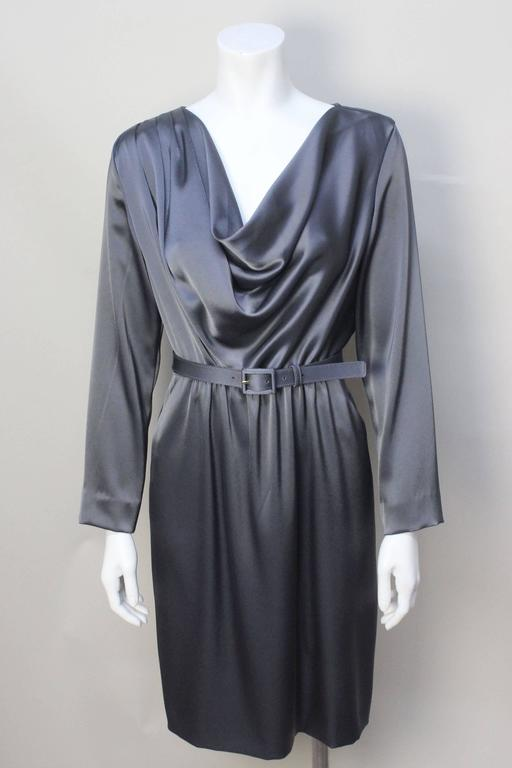 This elegant St. Johns dress drapes beautifully on the body. A deep cowl neck front is weighed on the inside to hang perfectly. The acetate blend feels like the softest silk. The dress gathers slightly at the waist and is cinched with a matching