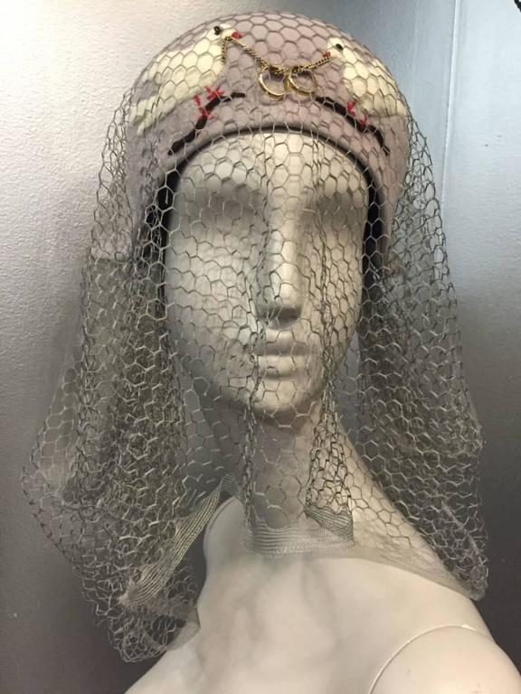 1940s Rare and unusual Irina Roublon couture hat with twin dove appliqués, gray silk veiling and intertwined 14K gold wedding bands. Three original matching hat pins included.