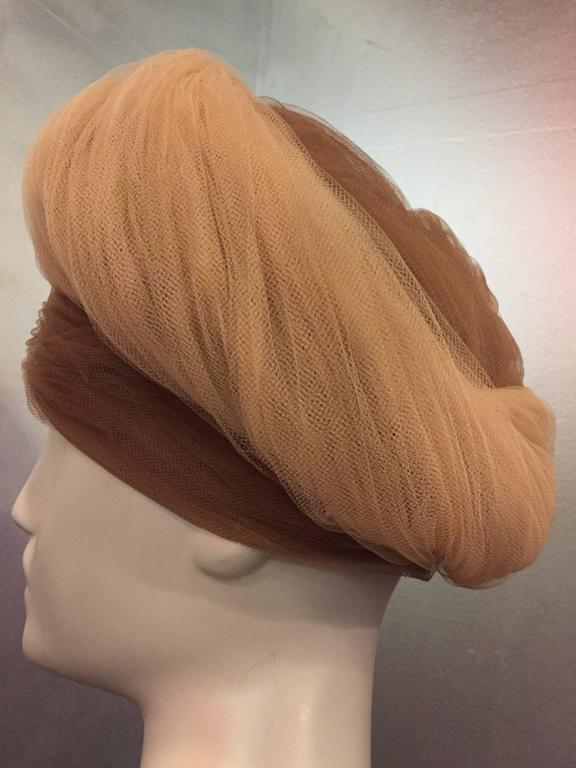 1960s D. Charles beige and camel two-tone soft silky tulle wrapped and gathered in a turban style structured horsehair hat.