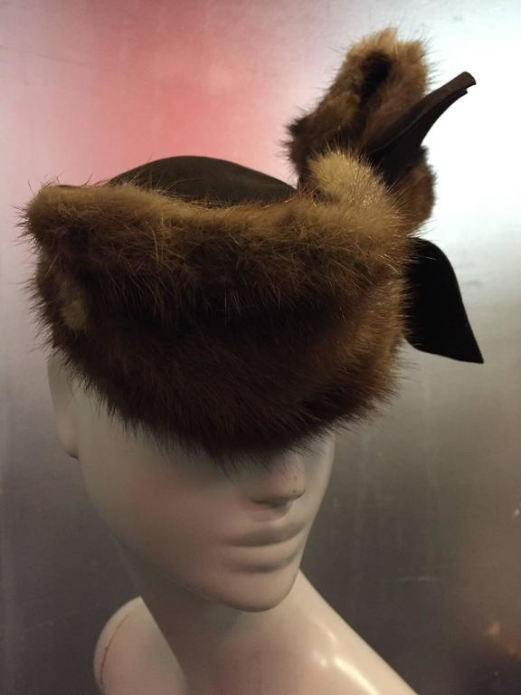 A wonderfully quirky 1940s mink and brown wool felt hat with back strap and mink bow jutting out to one side.