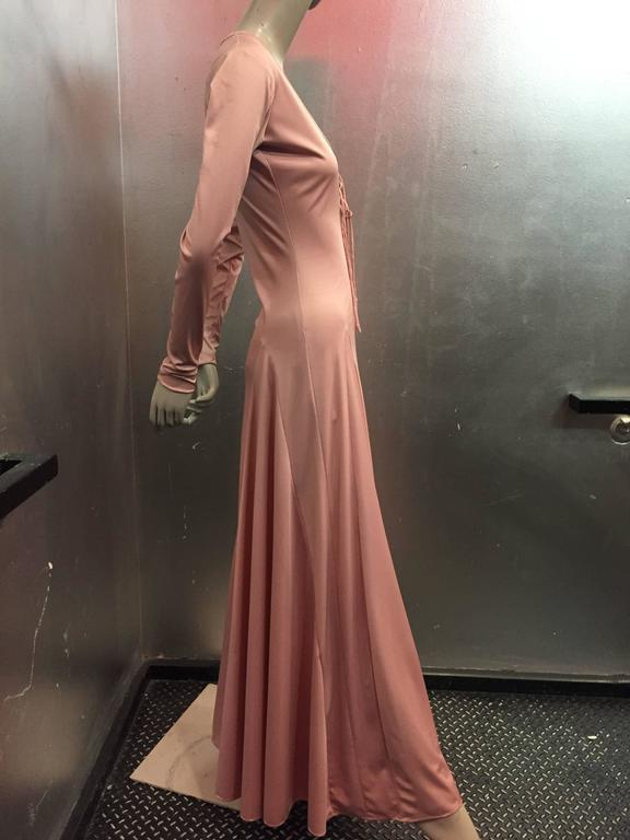 A sexy 1970s Esteban rose pink silk jersey disco gown or maxi dress with lace up detail at neckline, long sleeves and flared hemline. Great for Dancing!! Marked a size 8. Fits a modern 4-6.