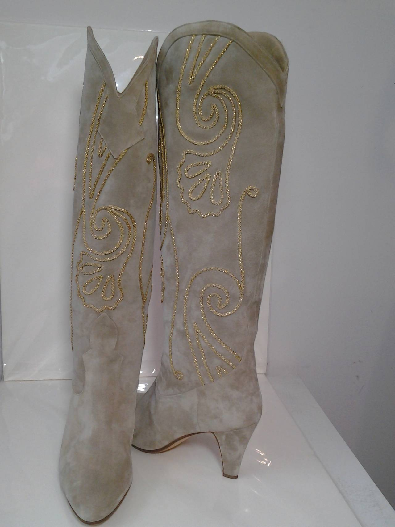 A gorgeous pair of 1980s Andrea Pfister taupe suede western-styled heeled boots.  Uppers are embellished with gold soutache braid work.