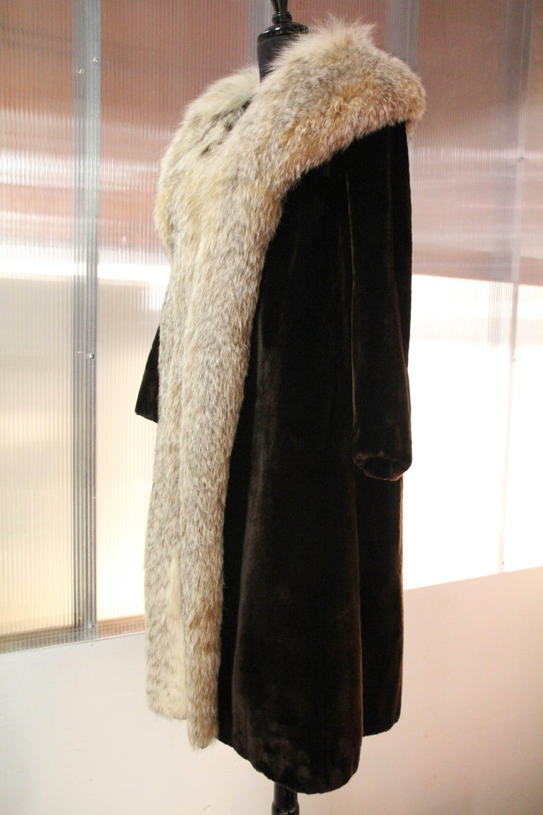 1960s Sheared beaver coat with plush Lynx collar and trim. silk lined. Made by Herbert's, San Francisco's finest fur salon at the time.  Bracelet length sleeves. Fits up to a size 12.