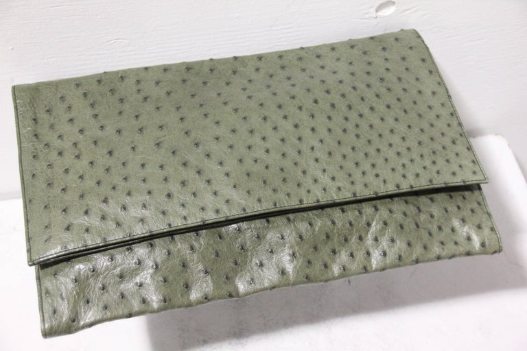 This is a wonderful 1970's Loewe of Madrid Ostrich leather moss green double-flap envelope style clutch . Features black leather interior and exquisite craftsmanship.