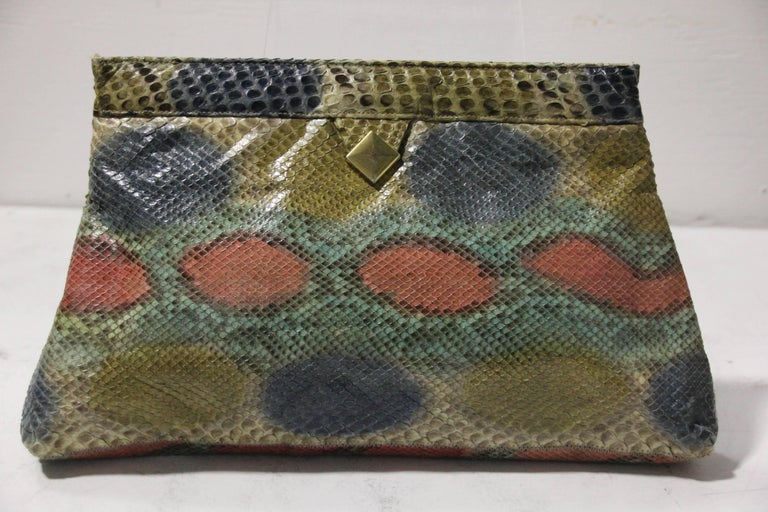 1970's Margolm airbrushed snakeskin clutch in array of green, blue and mauve. Great color combination makes this a versatile clutch to any wardrobe. Nice medium size for all your amenities. Easy spring-like mechanism for opening and closing with a