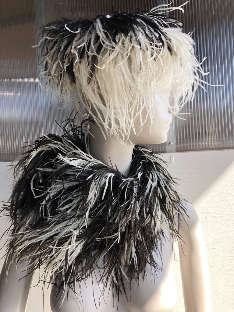 1950s Rare William J. black and white ostrich feather saucer-style hat, with center, top button embellishment.  Sold with a beautiful black and white feather boa that matches, but was not originally a set. William J. is better-known as famed