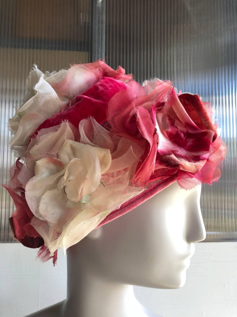 A gorgeous 1950s Mr Josephs spring flower pot-shaped hat with pink, white and fuchsia silk florals mounted on a stiffened net base and embellished with a pink velvet ribbon band.  Medium size.