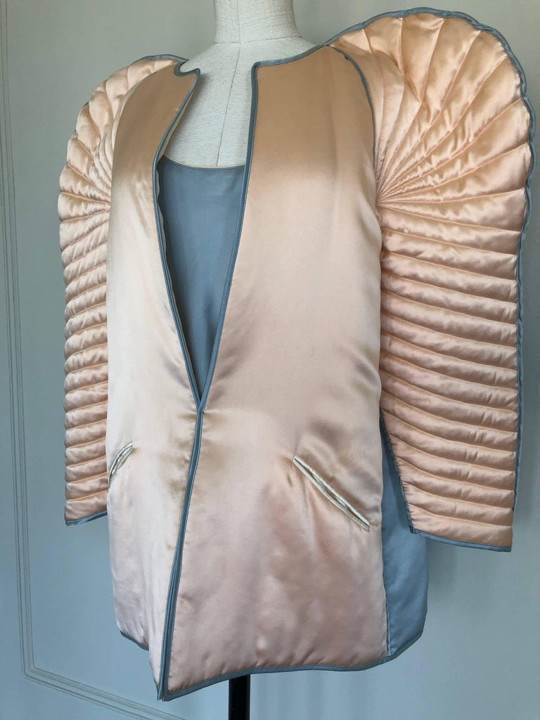This dramatic Fernando Sanchez quilted bed jacket ensemble was featured in American Vogue c.1983 and was shot by Helmet Newton. Fernando Sanchez was known for his provocative lingerie collections, which, though designed for elegant boudoirs, were