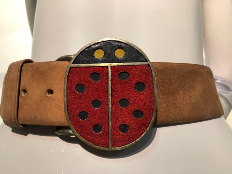 An adorable 1960s Vera Mod ladybug metal and suede belt buckle with original brown beveled-edge leather belt. Size Small.  A