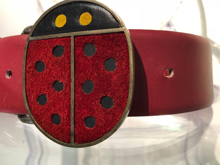 An adorable 1960s Vera Mod ladybug metal and suede belt buckle with original red beveled-edge leather belt. Size Small.  A