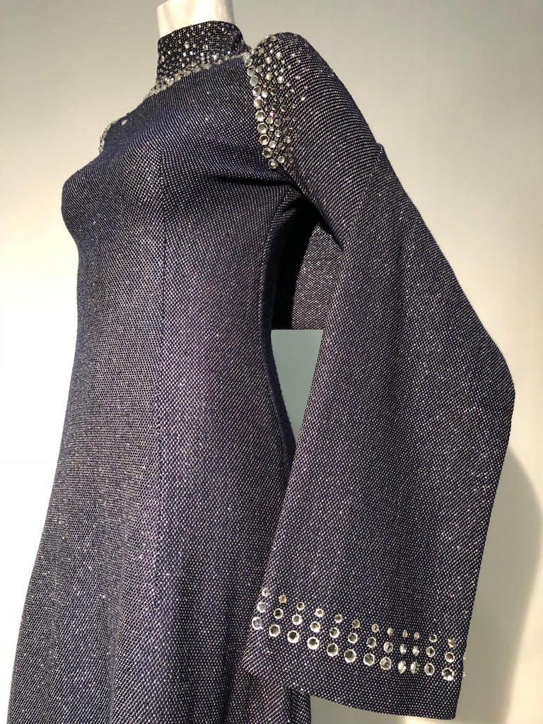 A wonderful 1960s Pauline Trigère slate blue wool and silver metallic knit gown with long sleeves and incredible futuristic styled rhinestone embellished yoke at shoulders. Matching rhinestone embellished stole. Zipper at back.