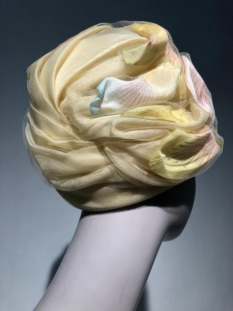 1960s Christian Dior Pale Yellow Silk Beehive Turban Hat W/ Large Pastel Petals In Excellent Condition For Sale In San Francisco, CA