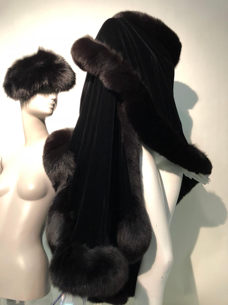 These two Halston original pieces from different eras of Halston`s career make a striking ensemble:  a 1970s double-sided silk velvet stole trimmed in plush fox fur is luxurious and generous in proportion. The 1960s genuine fox fur hat is an example