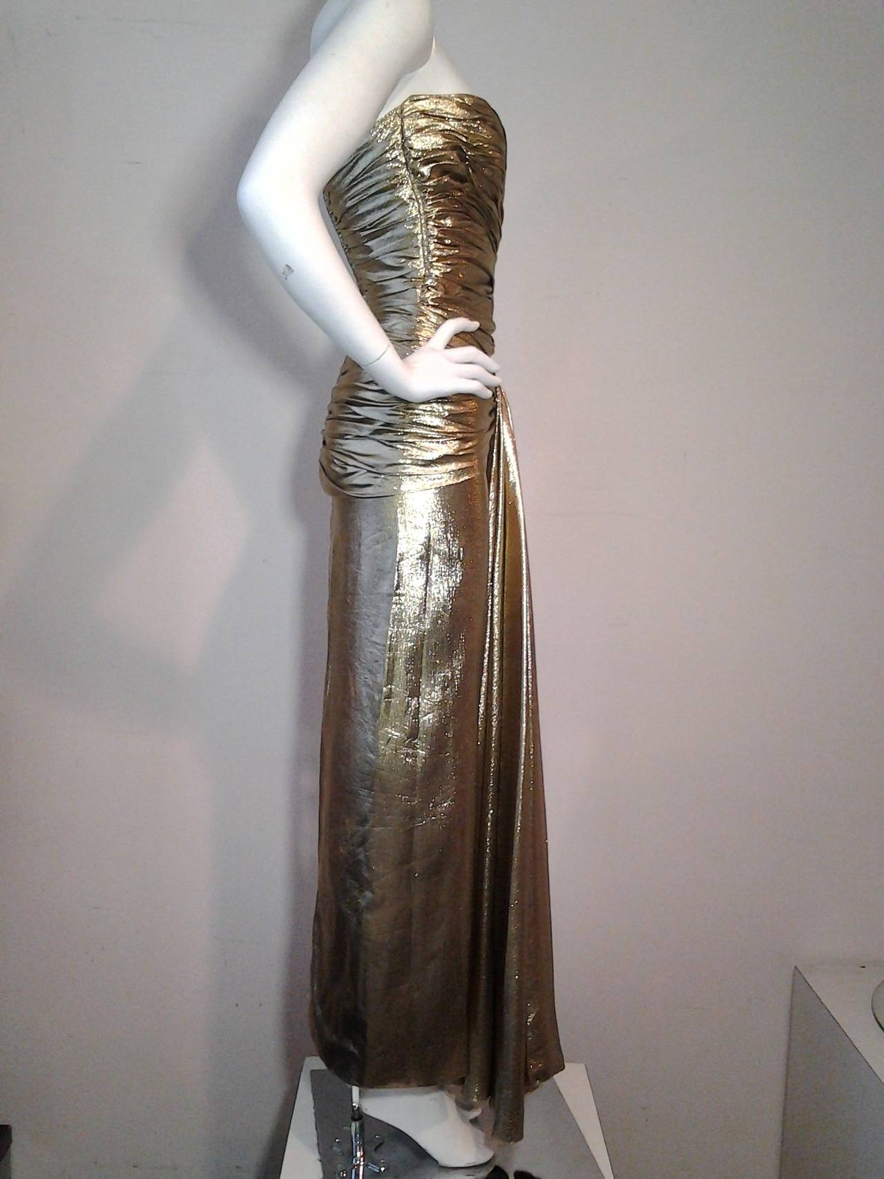 1979 Vicky Tiel gold lame gathered bodice gown with waterfall front. Fully boned with back zip closure.