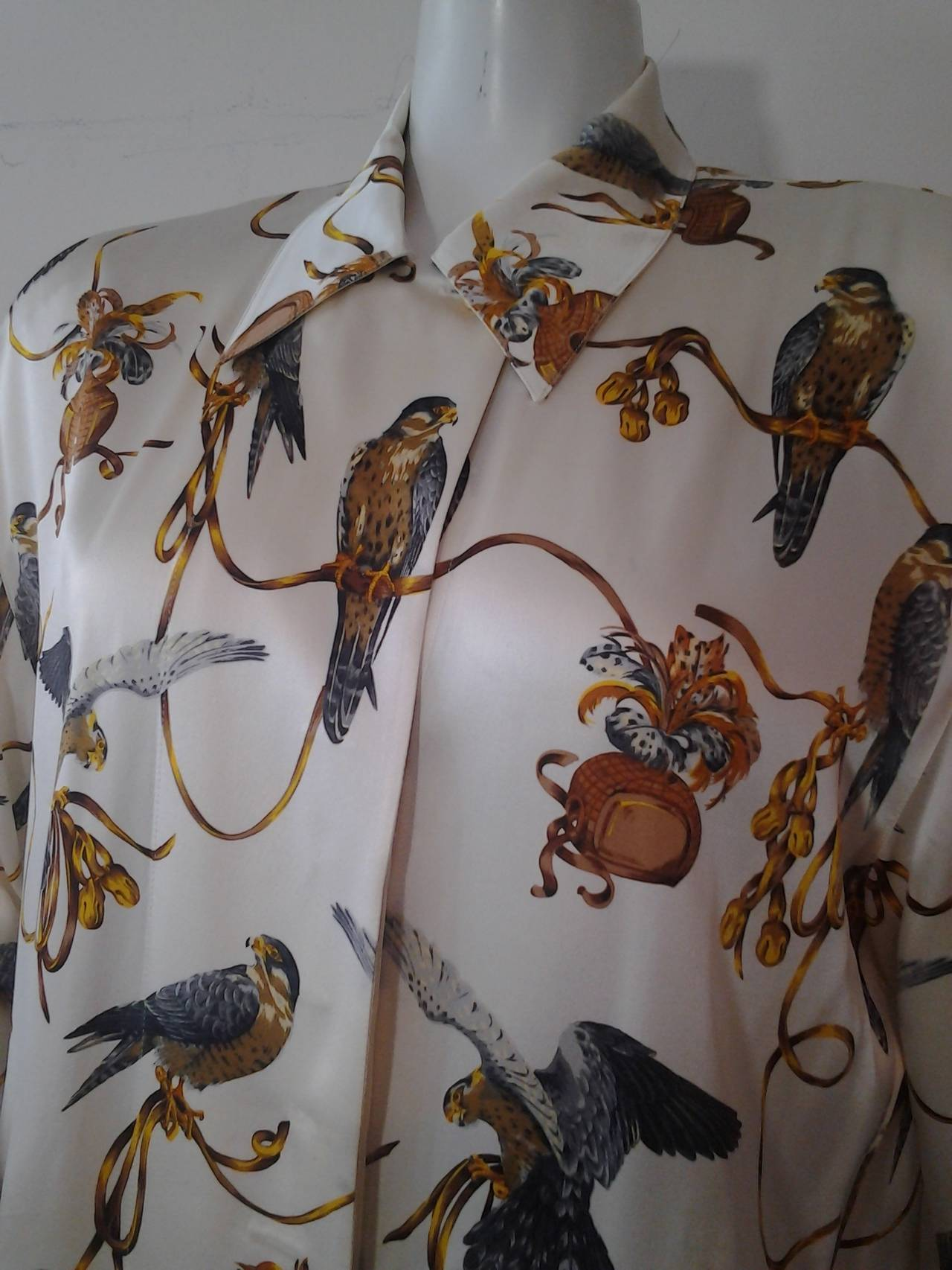 98e11f7b4706c A beautiful 1980s Escada silk blouse w a beautiful falcon print over the  entire blouse.