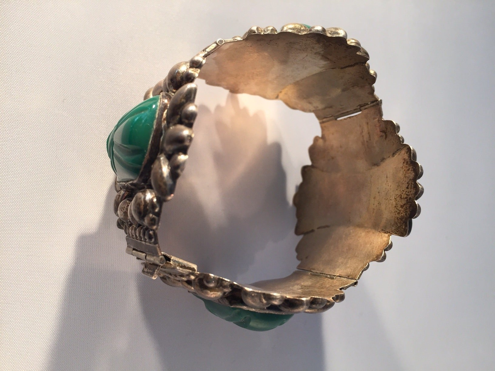 1940s Mexican Silver Hinged Cuff Bracelet with Jadeite Masks 2