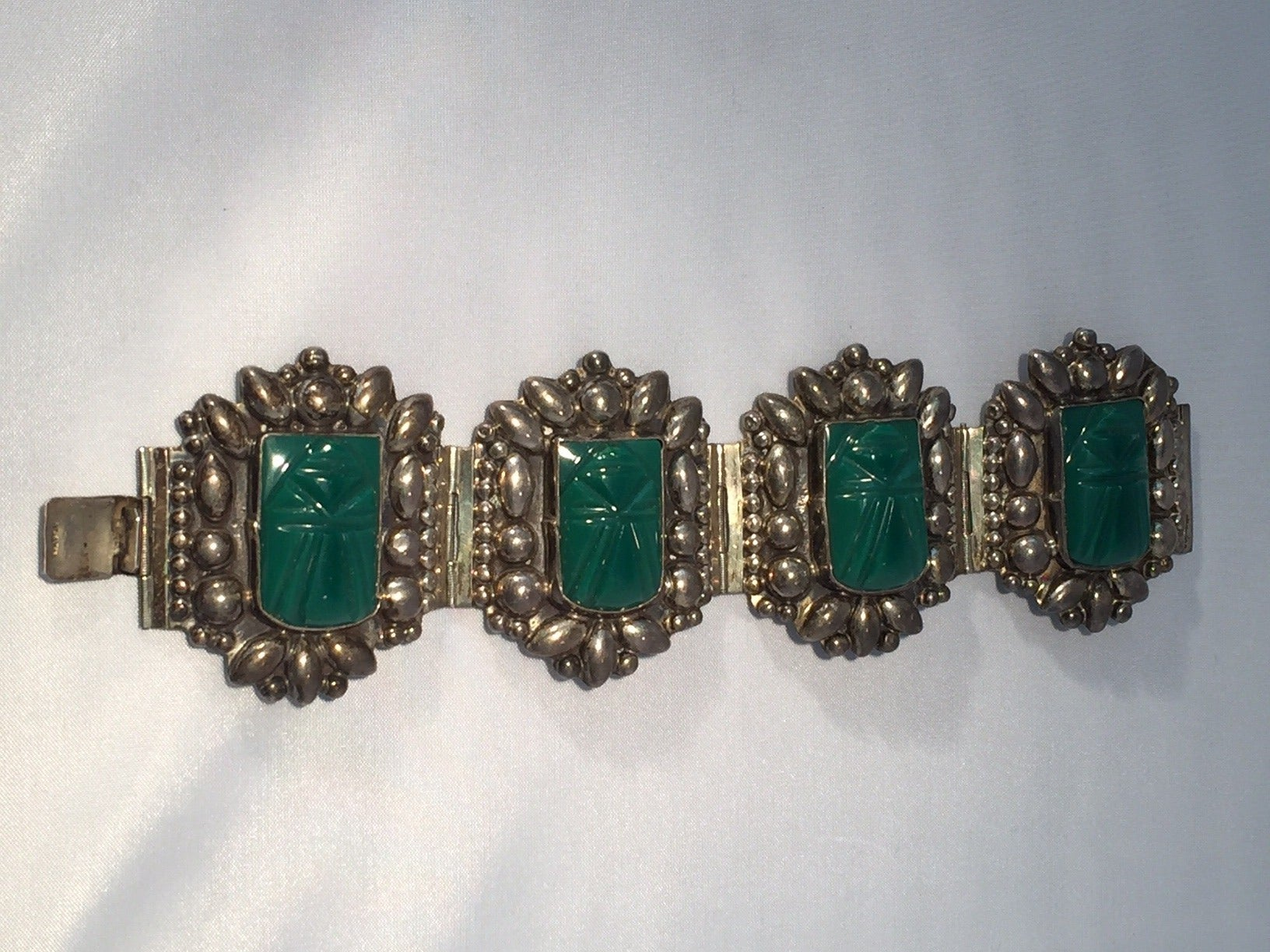 1940s Mexican Silver Hinged Cuff Bracelet with Jadeite Masks 3