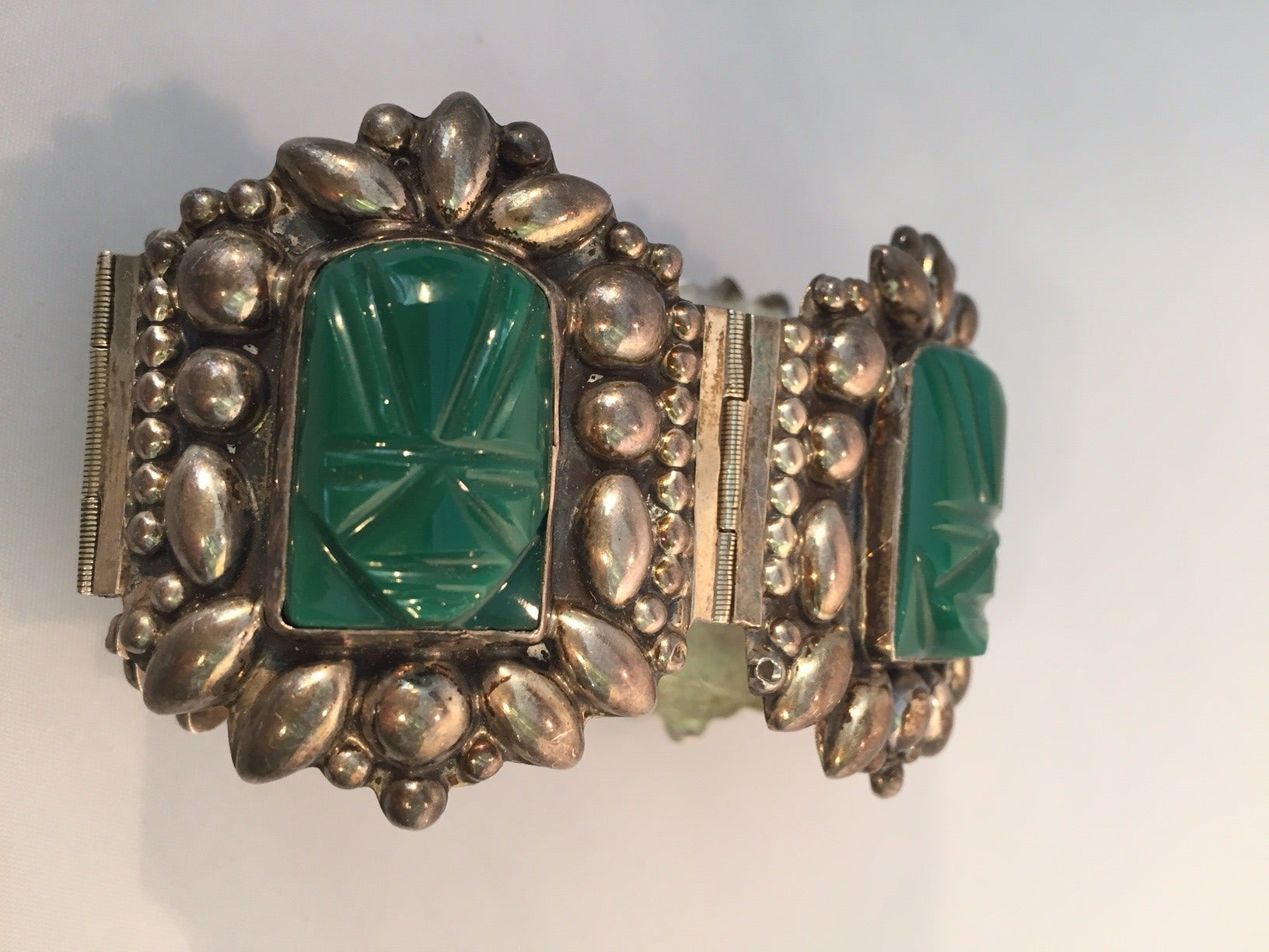 1940s Mexican Silver Hinged Cuff Bracelet with Jadeite Masks 4