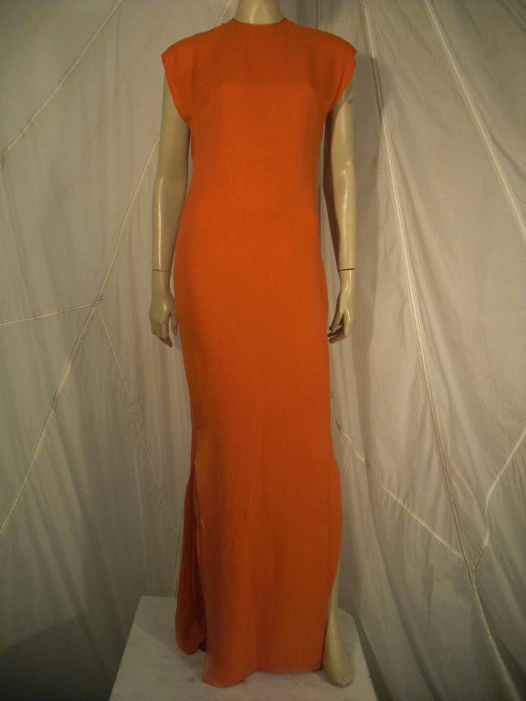A divine 1970s James Galanos orange silk chiffon multi-layered column gown:  Sleeveless with side slit.  Jacket does not close, but hangs free and open.  Back has button and keyhole opening, no zip.