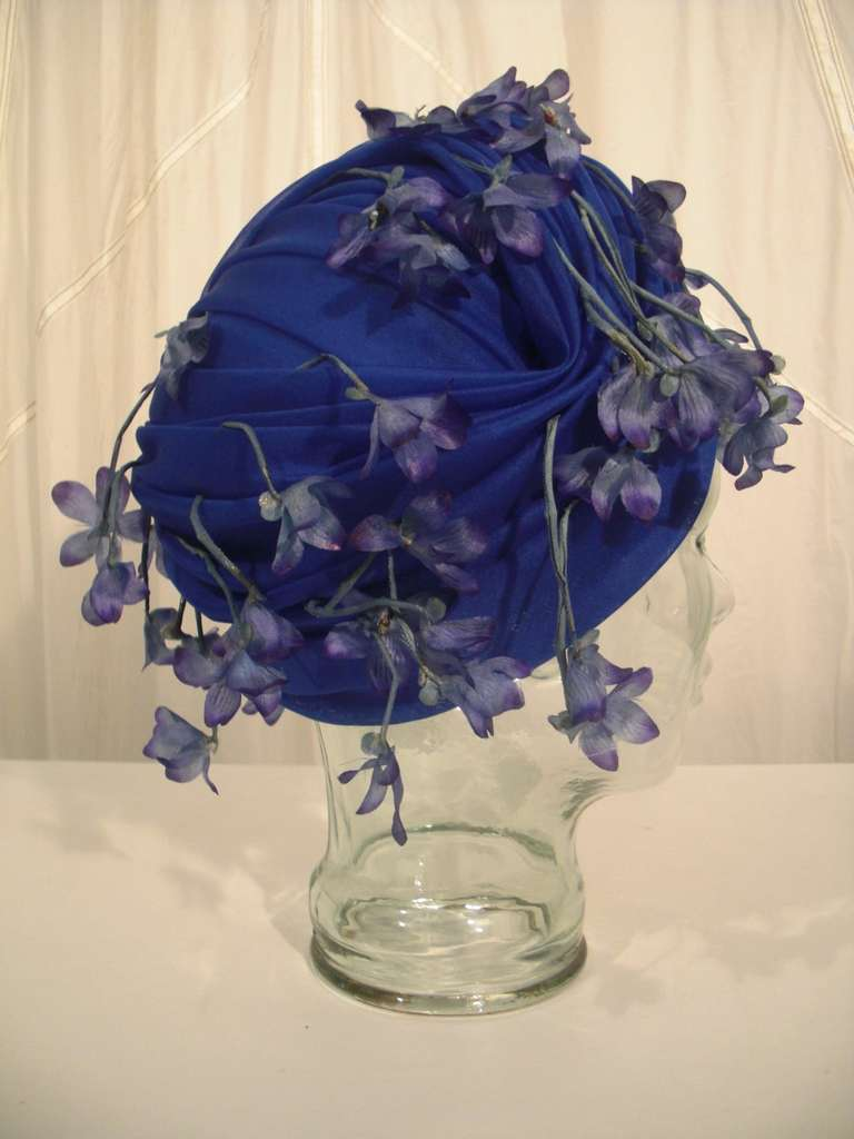 A fabulous and whimsical 1960s Cathay of California cobalt blue turban-style hat with dangling silk violets.  So much fun!