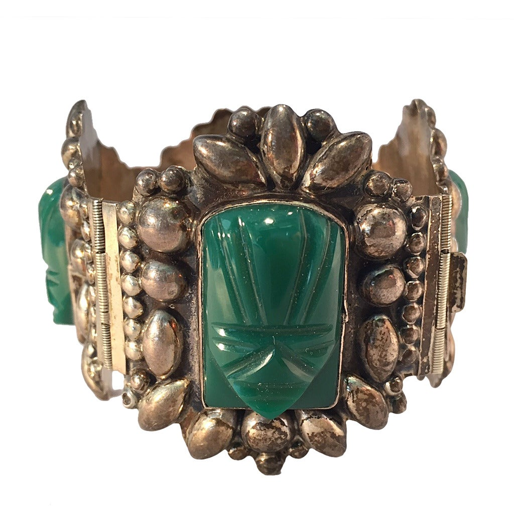1940s Mexican Silver Hinged Cuff Bracelet with Jadeite Masks 1